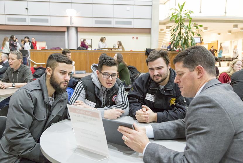 Alumni Looking at Tablet Presentation