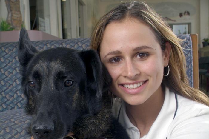 Woman and black dog
