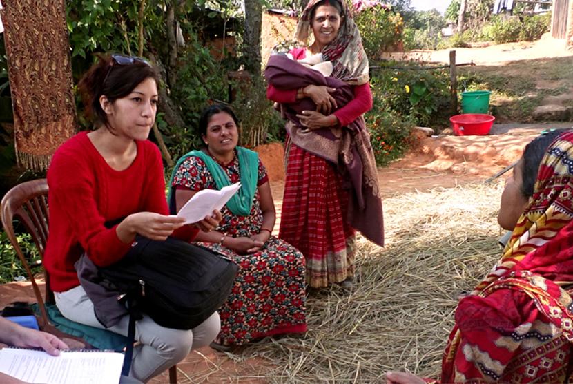 Volunteer interviewing international women