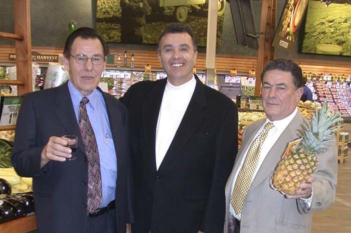 Three men and a pineapple