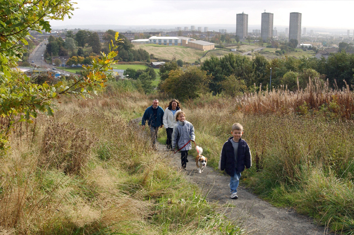 Family Walking up a path through a field