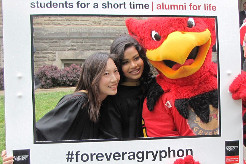 Gryph with New Grads