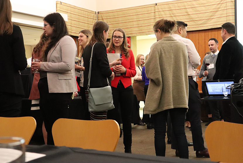 students standing and networking