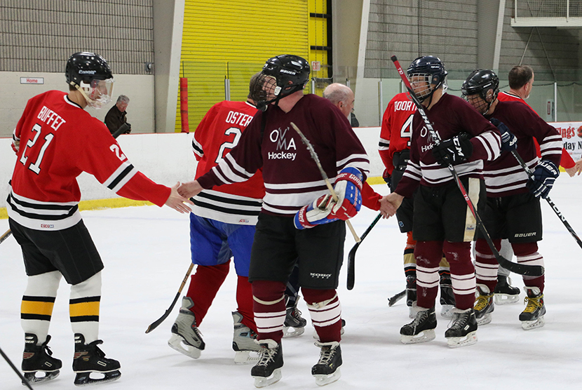 hockey players shaking hands