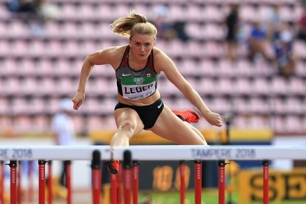 girl jumping over hurdle