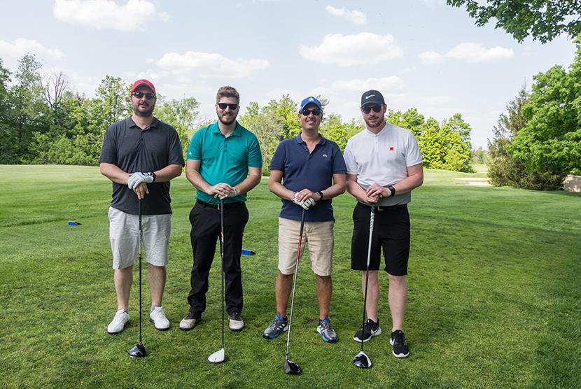 4 men golfing