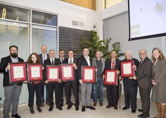 All award winners standing with awards in hand