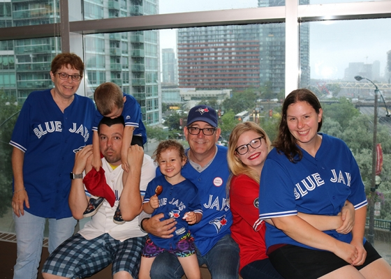 family dressed in toronto blue jays gear